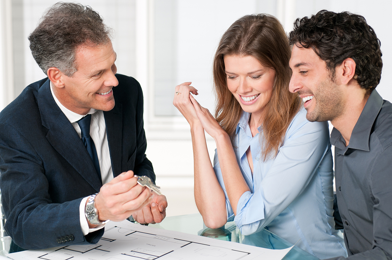 real estate agent chatting with clients